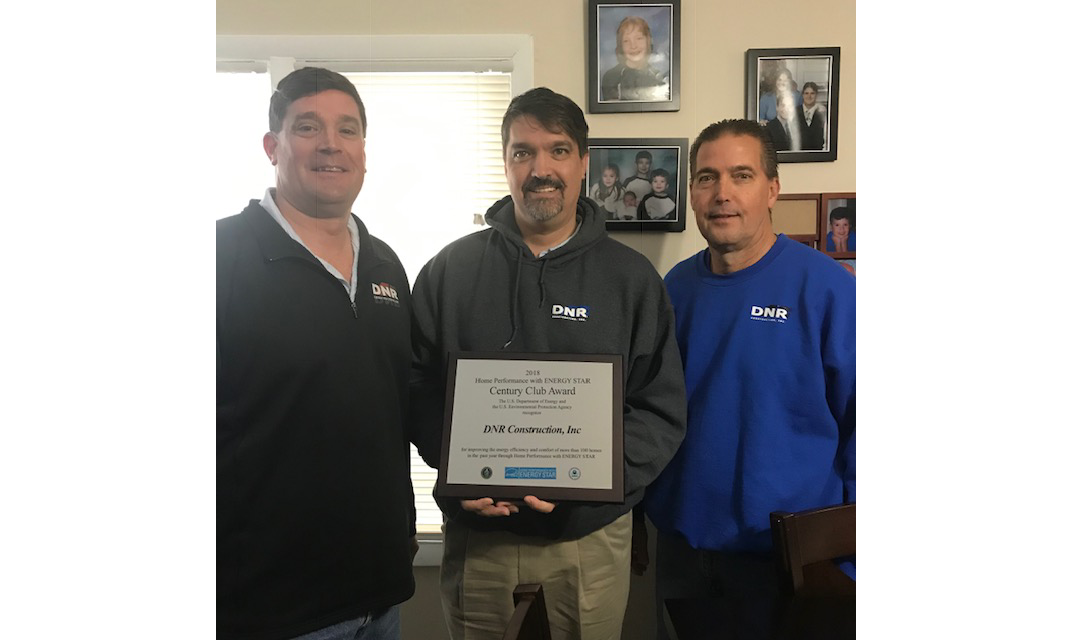 DNR staff holds their contractor of the year award