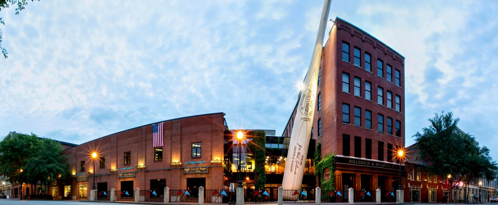 an exterior shot of the Louisville slugger factory with a jumbo bat