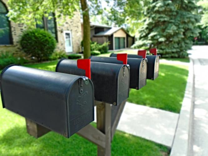 black mailboxes with red flags