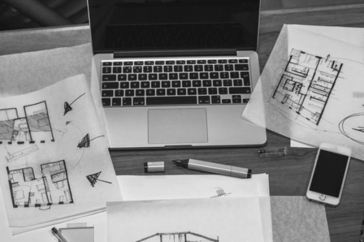 laptop and architectural plans