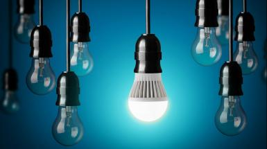 light bulbs dangling in front of a blue background